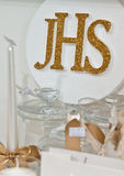 JHS - First Holy Communion articles on shelf in a shop Stock Photos