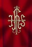 JHS. Traditional Catholic monogram at liturgical dress Stock Photo
