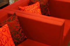 Jiaju. Scarlet sofa with its satin cushions royalty free stock images