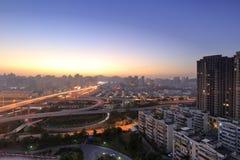 Jiangtou planskild korsningsolnedgång Arkivfoton