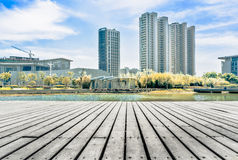 Jiangyin City Scenery. The wooden platform and the distant city building Royalty Free Stock Images