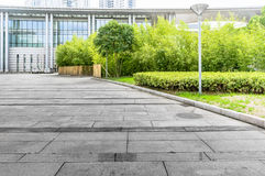 Jiangyin Cultural Center Plaza ground. Marble ground and building tree background Royalty Free Stock Photo