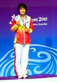 Jiao Liu. Singapore - Aug. 23: Toa Payoh Pool. Jiao Liu on the podium posing with the gold medal on Aug. 23, 2010. Inaugural Youth Olympic Games Aug. 14-26, 2010 royalty free stock photography