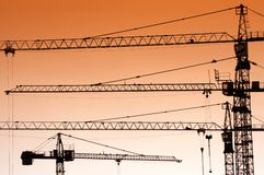 Jib crane silhouettes Royalty Free Stock Photo