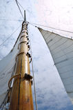 Jib and Wooden Mast of Schooner Sailboat Stock Image