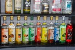 Row of bottles of cocktail ingredients in resort bar. Jibacoa Cuba - 25 January 2018: Row of bottles of cocktail ingredients in resort bar Royalty Free Stock Image