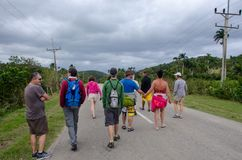 Tourists on walk in Caribbean Resort Royalty Free Stock Image