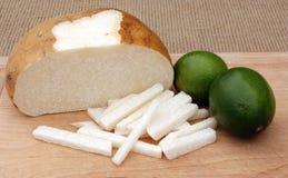 Jicama and Limes. Image of sliced jicama and ripe limes Stock Photos