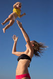 Jid baby up and down. Young beautiful women jiding her baby up and down Stock Photo