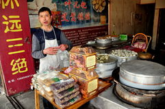 Jie Zi, China: Man in his Pastry Shop Stock Image