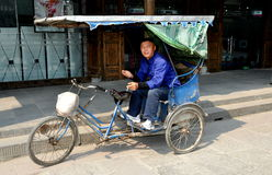 Jie Zi, China: Pedicab Driver on Chaoyang Road Stock Photo