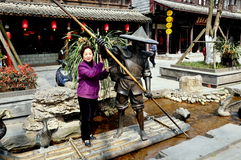 Jie Zi, China: Visitor Posing with Sculpture Royalty Free Stock Photo