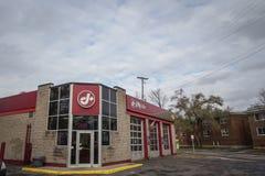 Jiffy Lube logo framme av deras lager i Ottawa, Ontario arkivfoto