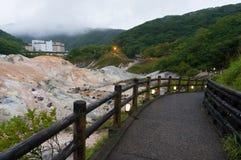 Jigokudani helvetedal och Daiichi Takimotokan hotell Royaltyfri Fotografi