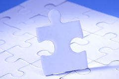Jigsaw. Human shaped jigsaw piece in vertical position on puzzle Stock Photo