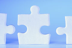 Jigsaw. Human shape jigsaw pieces are arranged in a row Stock Photo