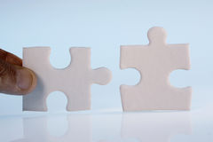 Jigsaw. Close up of jigsaw pieces in vertical position Stock Image