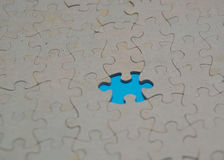 Jigsaw blue piece missing Stock Images