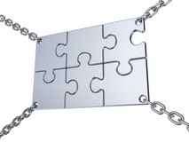 Jigsaw board sign on the chains. Stock Photo