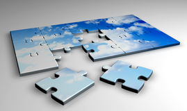 Jigsaw Clouds. 3d image of an incomplete jigsaw with a sky and clouds Stock Photo