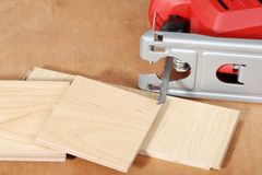 Jigsaw with cut wood flooring Royalty Free Stock Photography