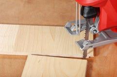 Jigsaw and cut wood flooring Stock Photos