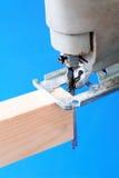Jigsaw cutting wood Royalty Free Stock Photo