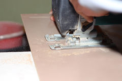 Jigsaw, electric saw cutting plank Royalty Free Stock Image