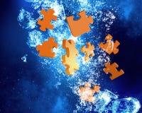 Jigsaw elements under water Stock Photos