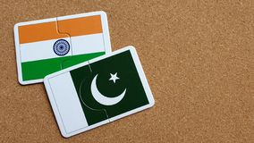 Flags of India and Pakistan. Jigsaw flags of India and Pakistan on cork board. Concepts of Relationship royalty free stock photo