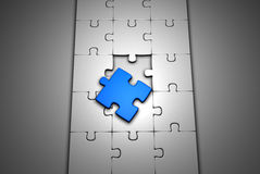 Jigsaw Floor. Incomplete jigsaw with a blue piece Royalty Free Stock Images