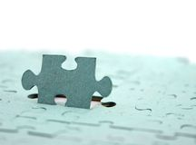 Jigsaw Focus on Upright piece Shallow DOF. Close up of a Jigsaw with element standing upright Royalty Free Stock Image