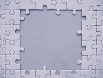 Jigsaw frame. Blue jigsaw frame Stock Photography