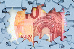 Jigsaw frame with ten euro bill Royalty Free Stock Images