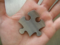 Jigsaw in a hand Royalty Free Stock Photography