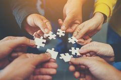 Jigsaw is a harmony among the group will not be impossible. Think of teamwork. Of successful businesspeople And teamwork quality stock photo