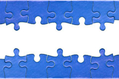 Jigsaw header and footer. Pieces from a genuine blue jigsaw puzzle arranged to form a page header and footer, isolated on a white background Stock Image
