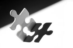 Jigsaw man. In strong light stock photography