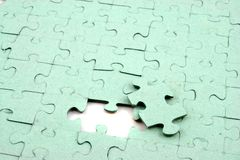Jigsaw One bit out. Close up of a Jigsaw with elements missing Stock Photo