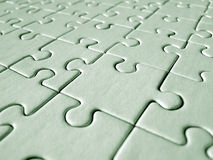 Jigsaw pattern. Green jigsaw background stock photos
