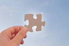 Jigsaw piece against sky Royalty Free Stock Photos