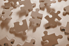 Jigsaw Piece with Dramatic Light Royalty Free Stock Photography