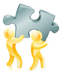 Jigsaw piece gold people Stock Photos