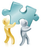 Jigsaw piece mascots. People carrying a giant jigsaw piece, partnership or teamwork business concept Stock Images