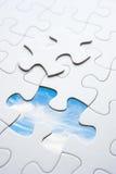 Jigsaw piece with sky in hole Stock Photos