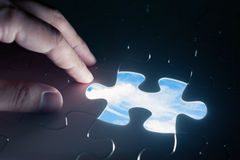 Jigsaw piece with sky in hole, conceptual image Stock Photography