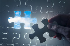 Jigsaw piece with sky in hole, conceptual image Royalty Free Stock Images