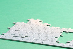 Jigsaw piece white Royalty Free Stock Images