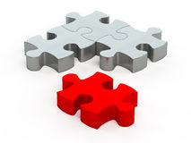Jigsaw pieces. Three gray jigsaw pieces with another in red which is a perfect fit with the other three Royalty Free Stock Photo