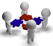 Jigsaw Pieces Being Joined Showing Teamwork And Assembling Royalty Free Stock Photos
